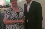 Australia Post MD/CEO Ahmed Fahour with Licensee Wendy who won the confectionery giveaway.