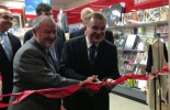 Phil Magennis (left) and Bruce Billson cutting the ribbon