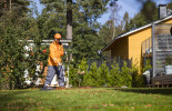 A Finnish postie raking the lawn - using the customer's rake, of course!